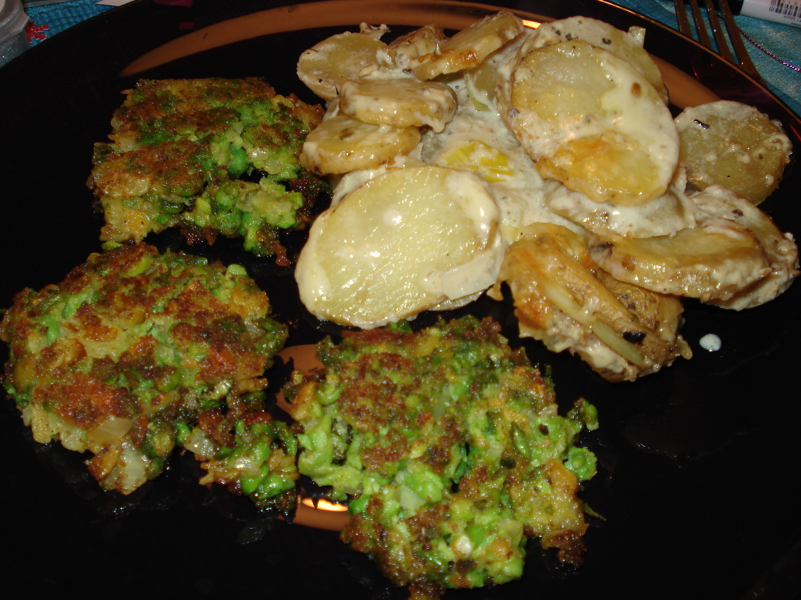 Green pea and carrot patties with potato gratin