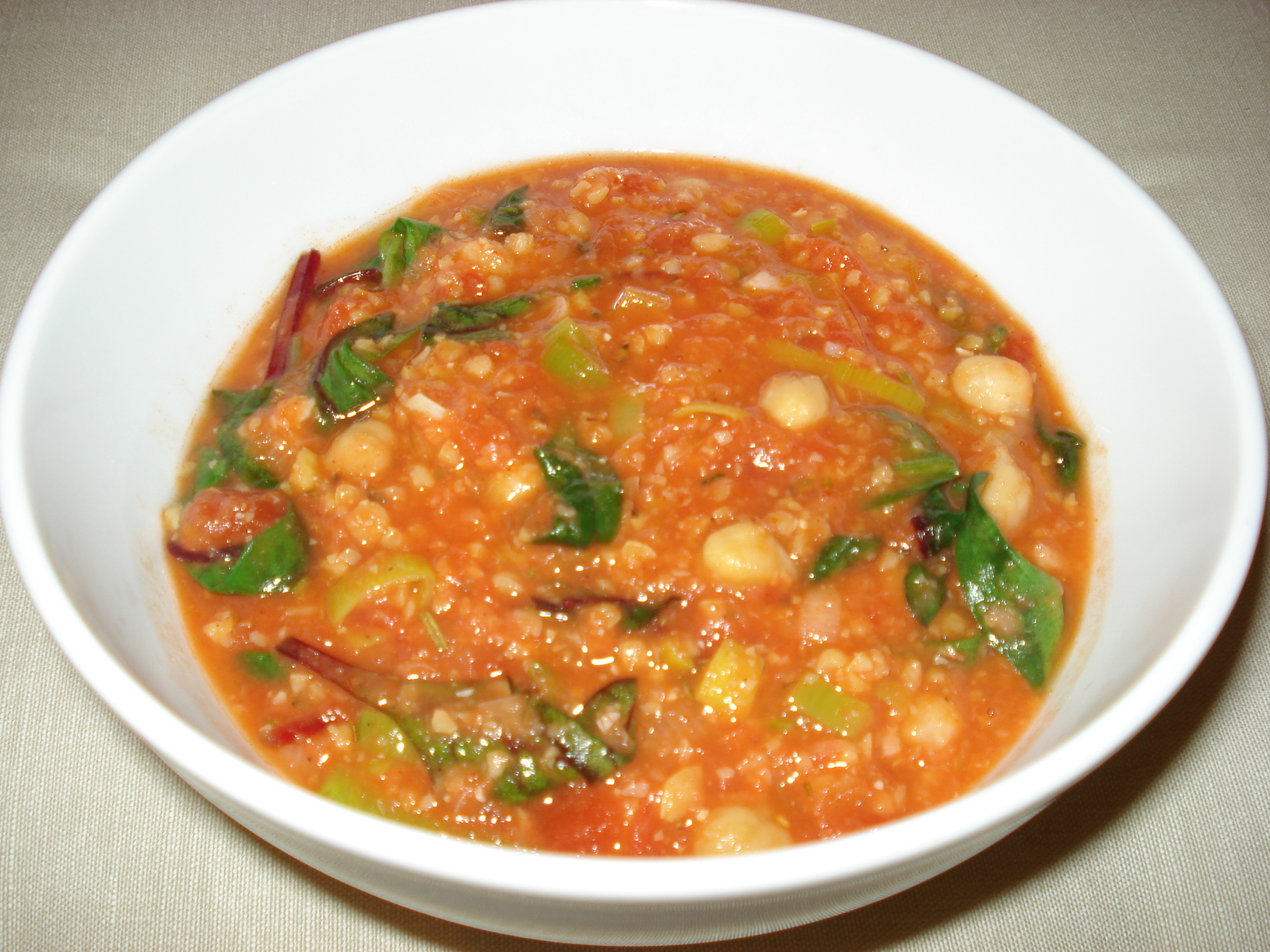 Tomato soup with chickpeas and chard