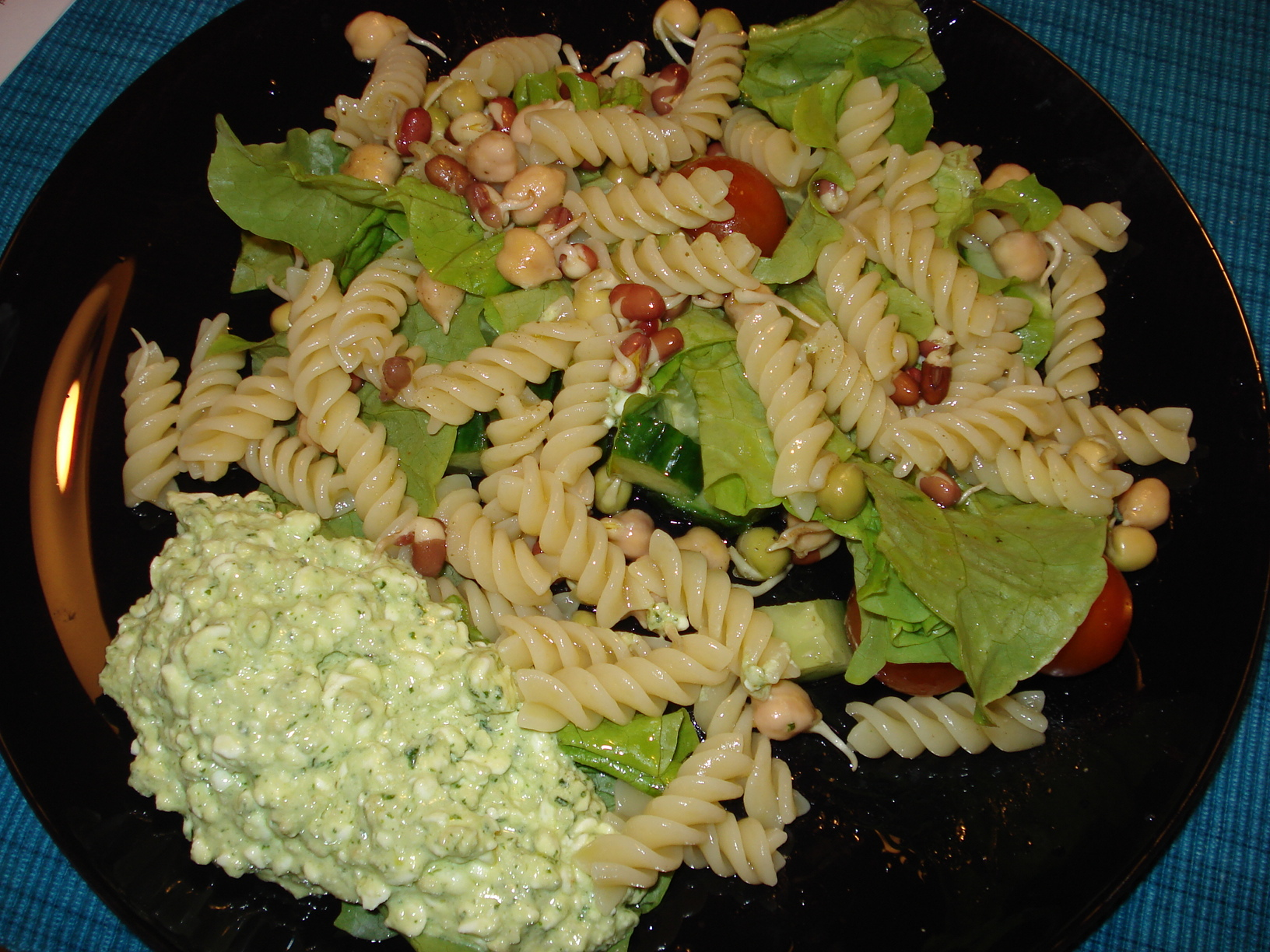 Pasta salad with fresh sprouts and pesto cottage cheese