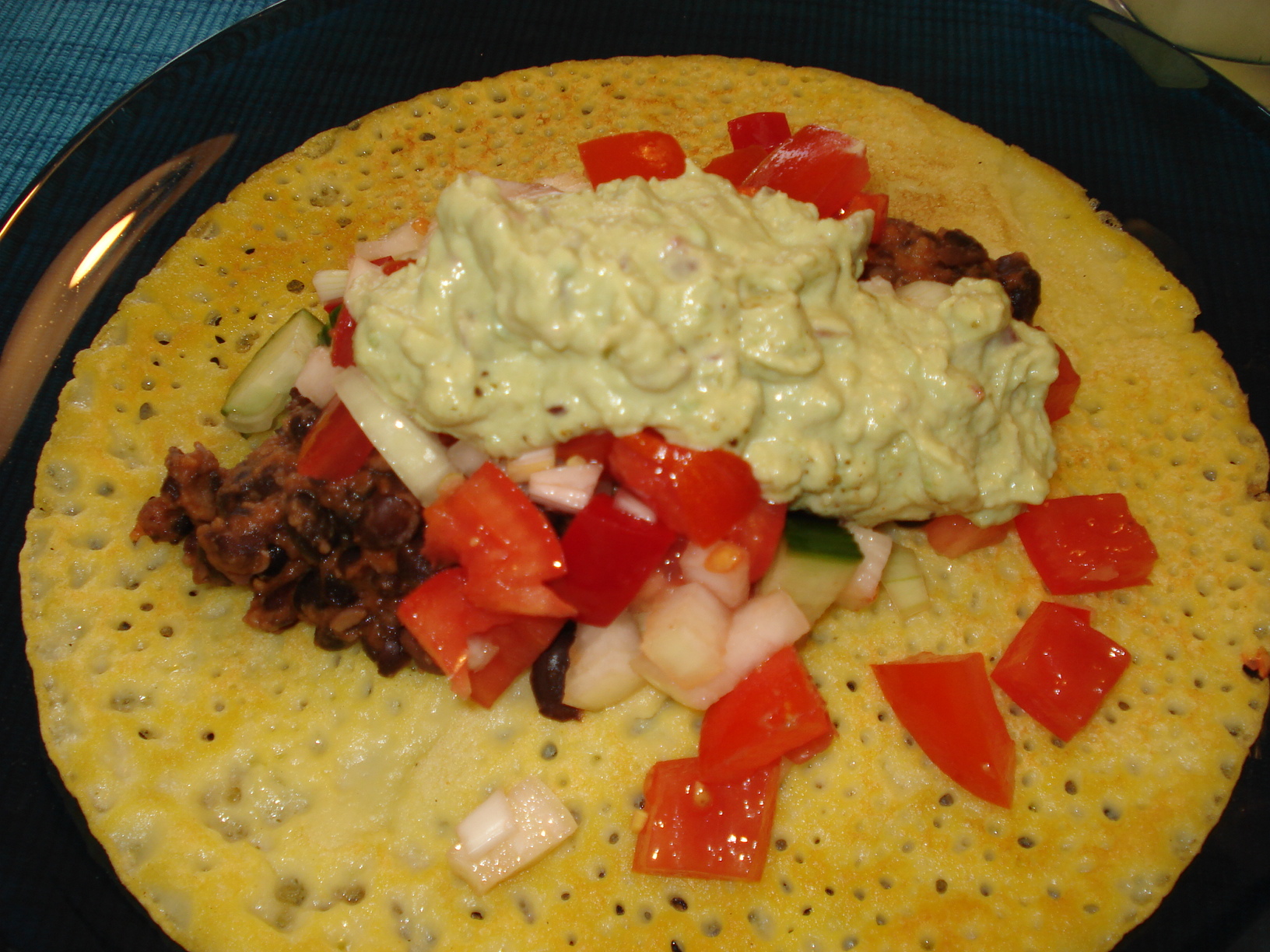Corn Tortillas with fried beans and guacamole