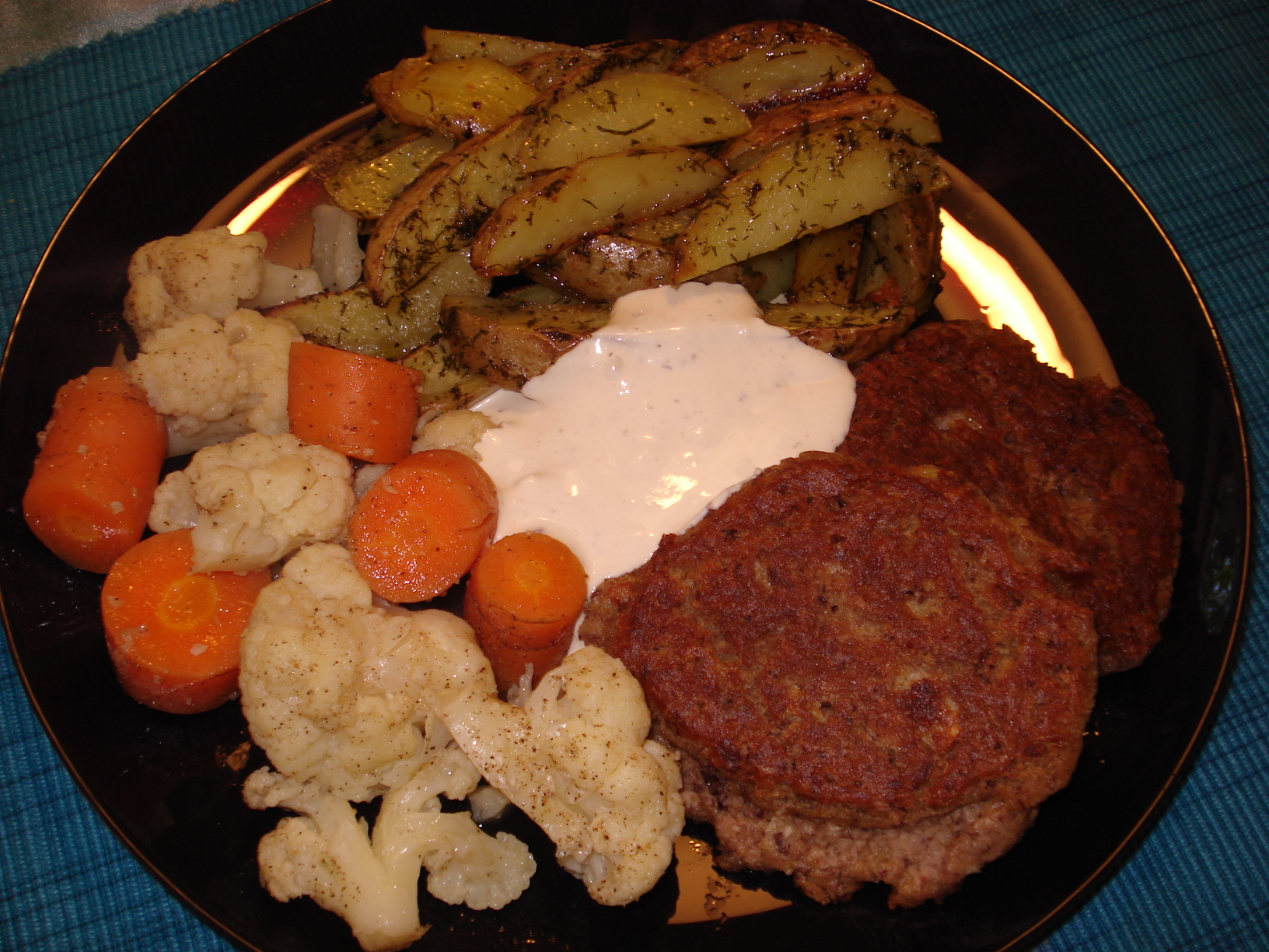 Bean patties with dill and garlic potato wedges and buttered vegetables