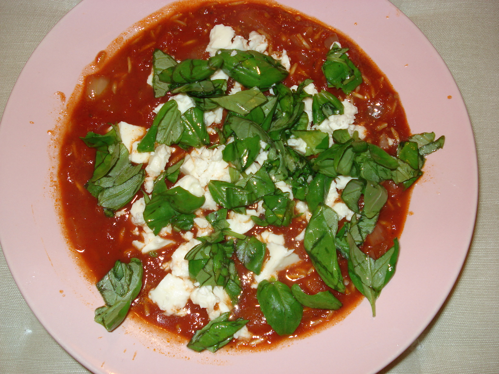 Tomato soup with rice, feta cheese and basil