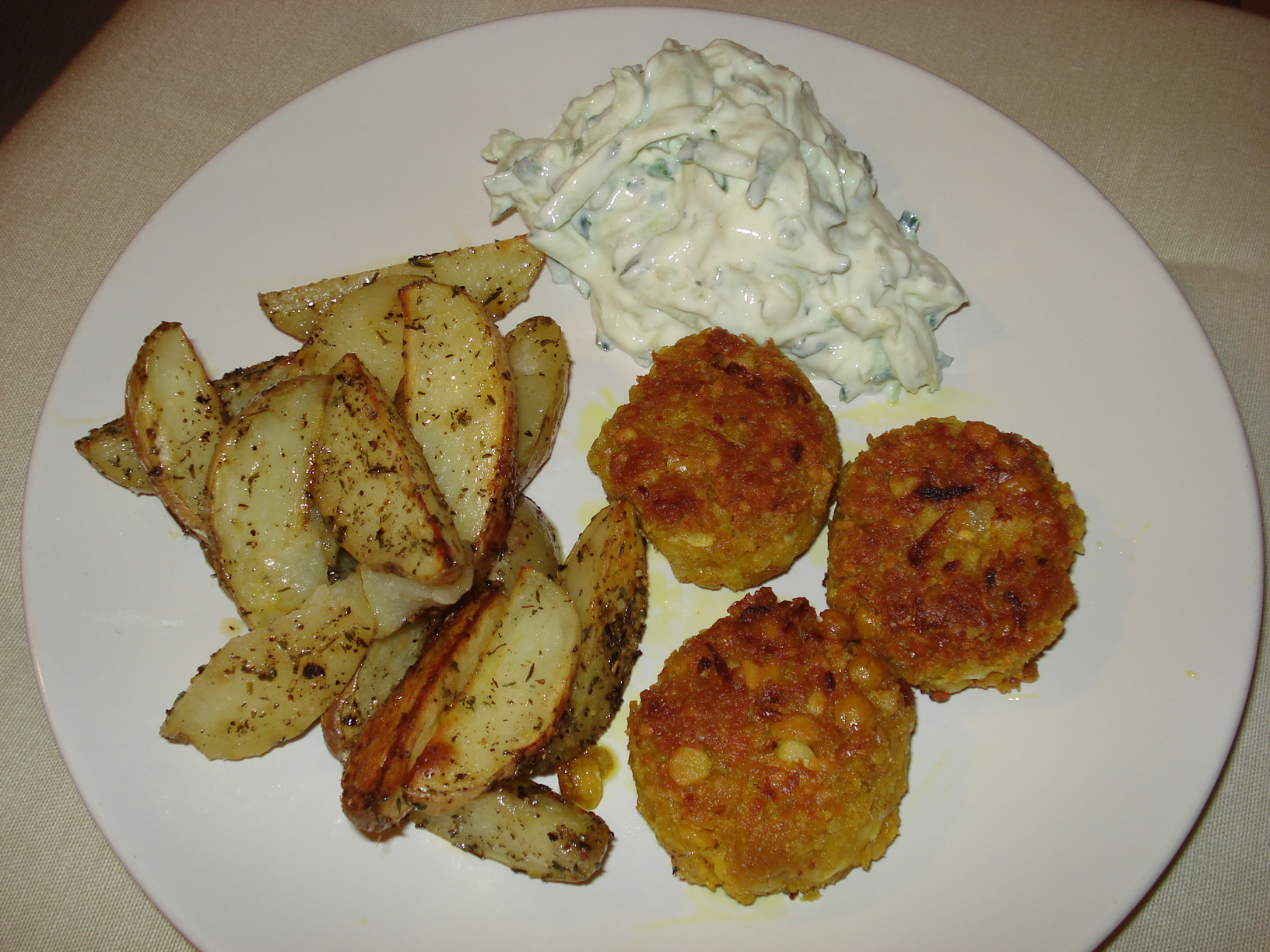 Curry chickpea patties with herbal potato wedges and tzatziki