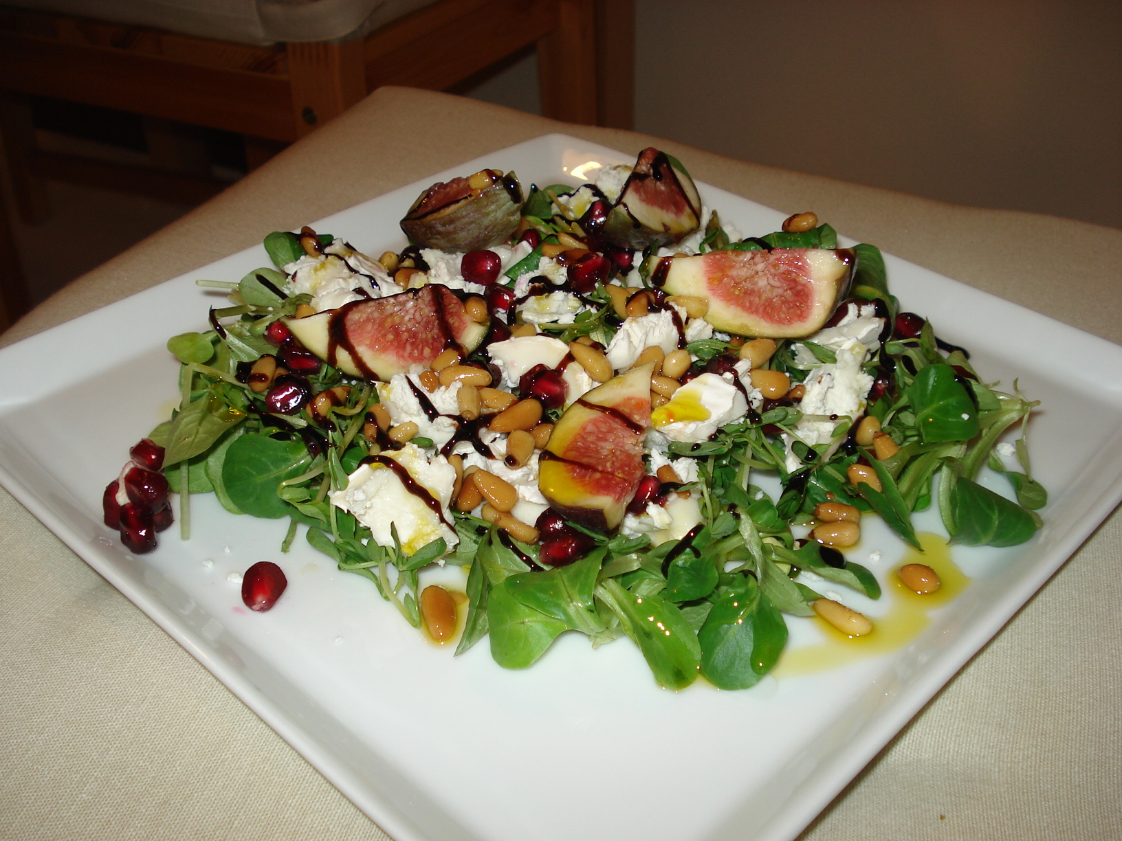 Goat cheese salad with fig, pomegranate and pine nuts