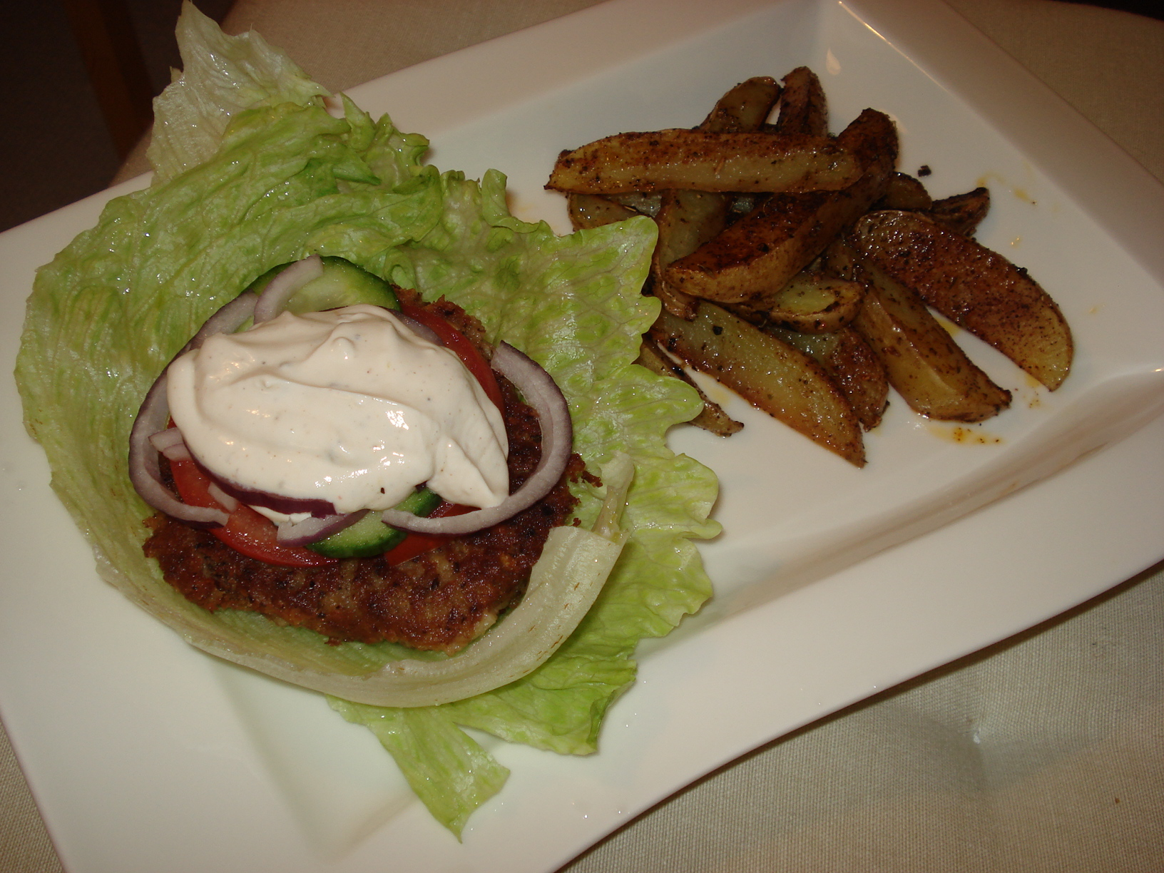 """Delifresh"" bean burgers with chilli potato wedges"
