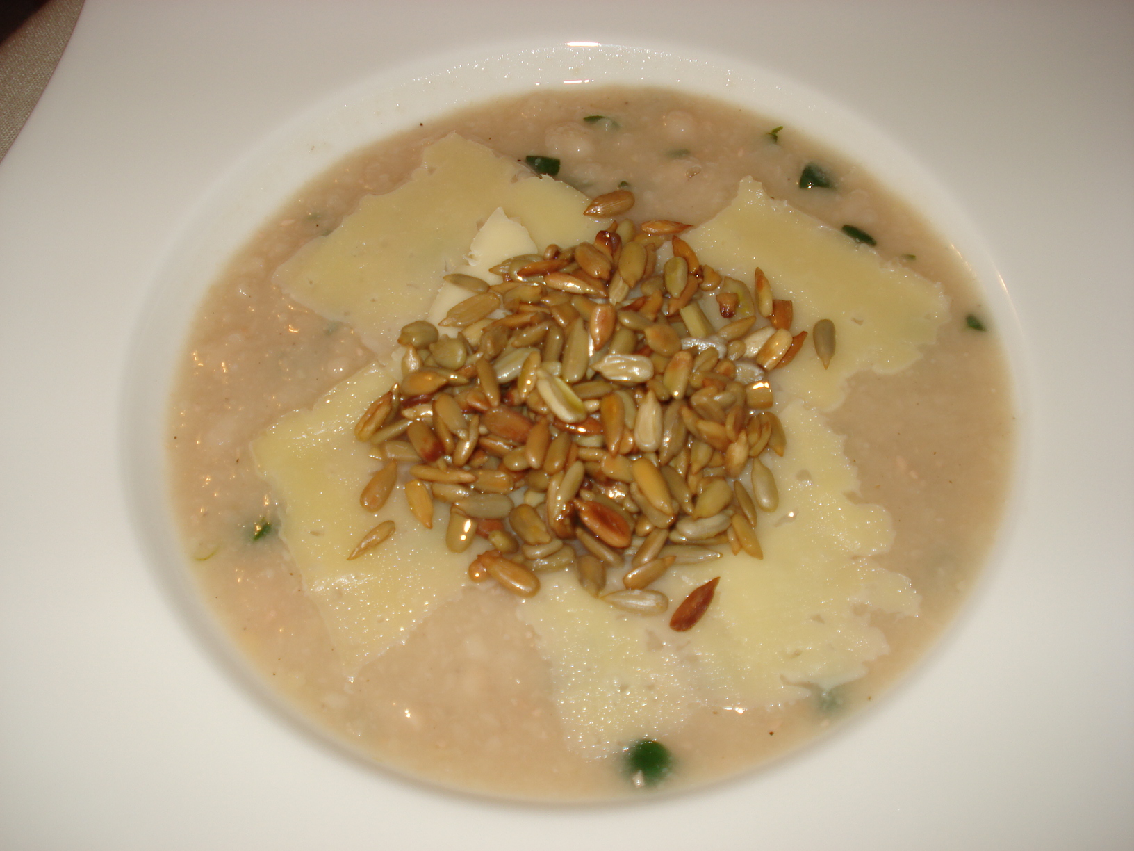 Bean soup with thyme, cheese and roasted sunflower seeds