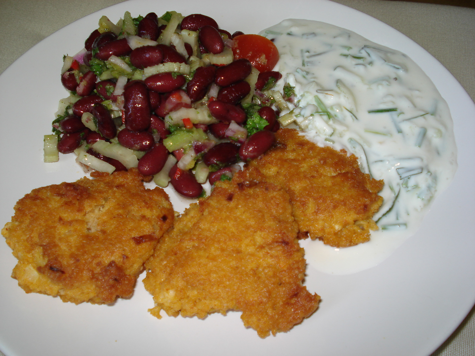 Millet patties with bean salad and herb tzatziki