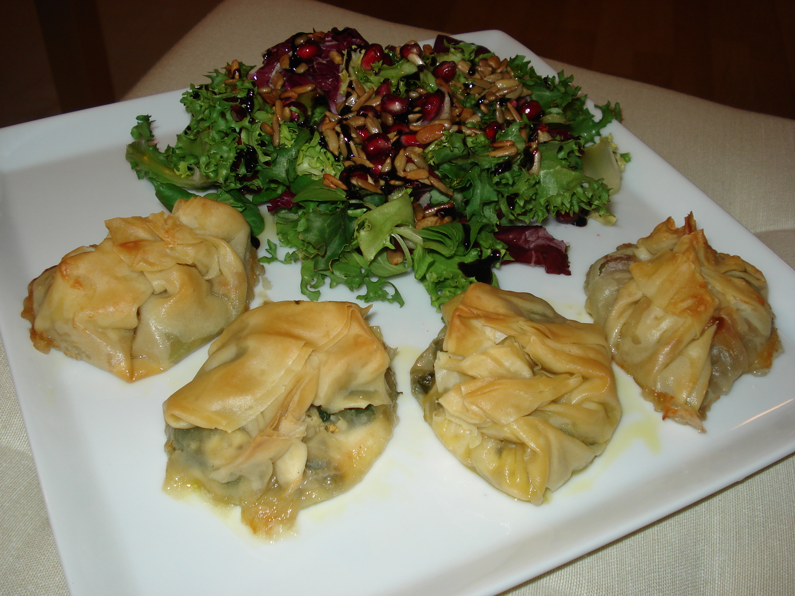 Filo bundles with goat cheese and figs and spinach and feta cheese