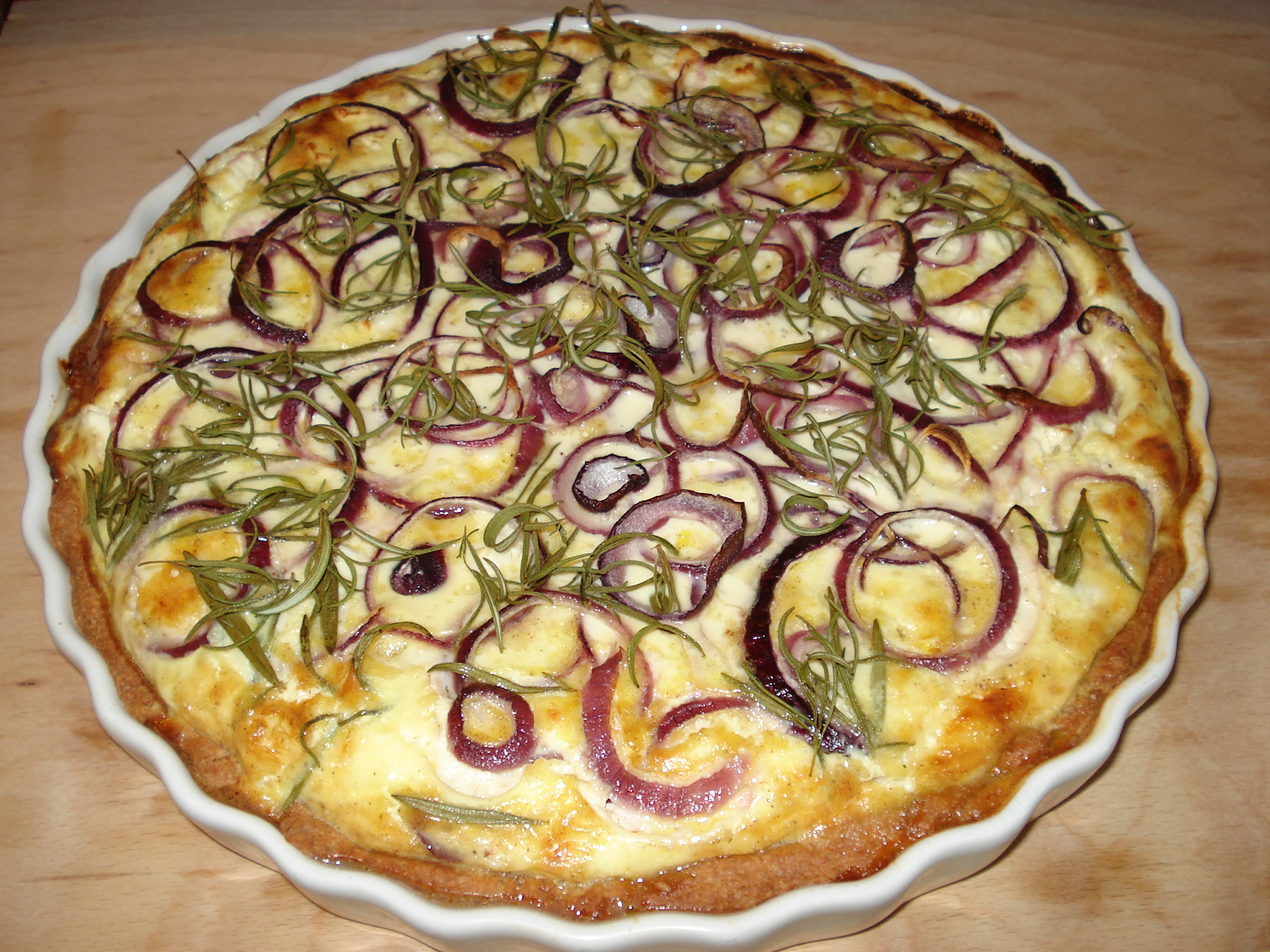 Potato, cheese and onion pie with rosemary
