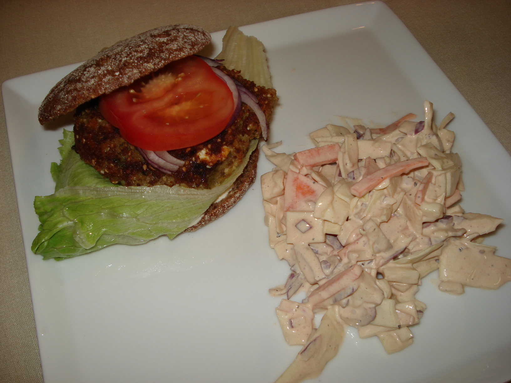 Lentil burgers with feta cheese and sun-dried tomatoes and coleslaw