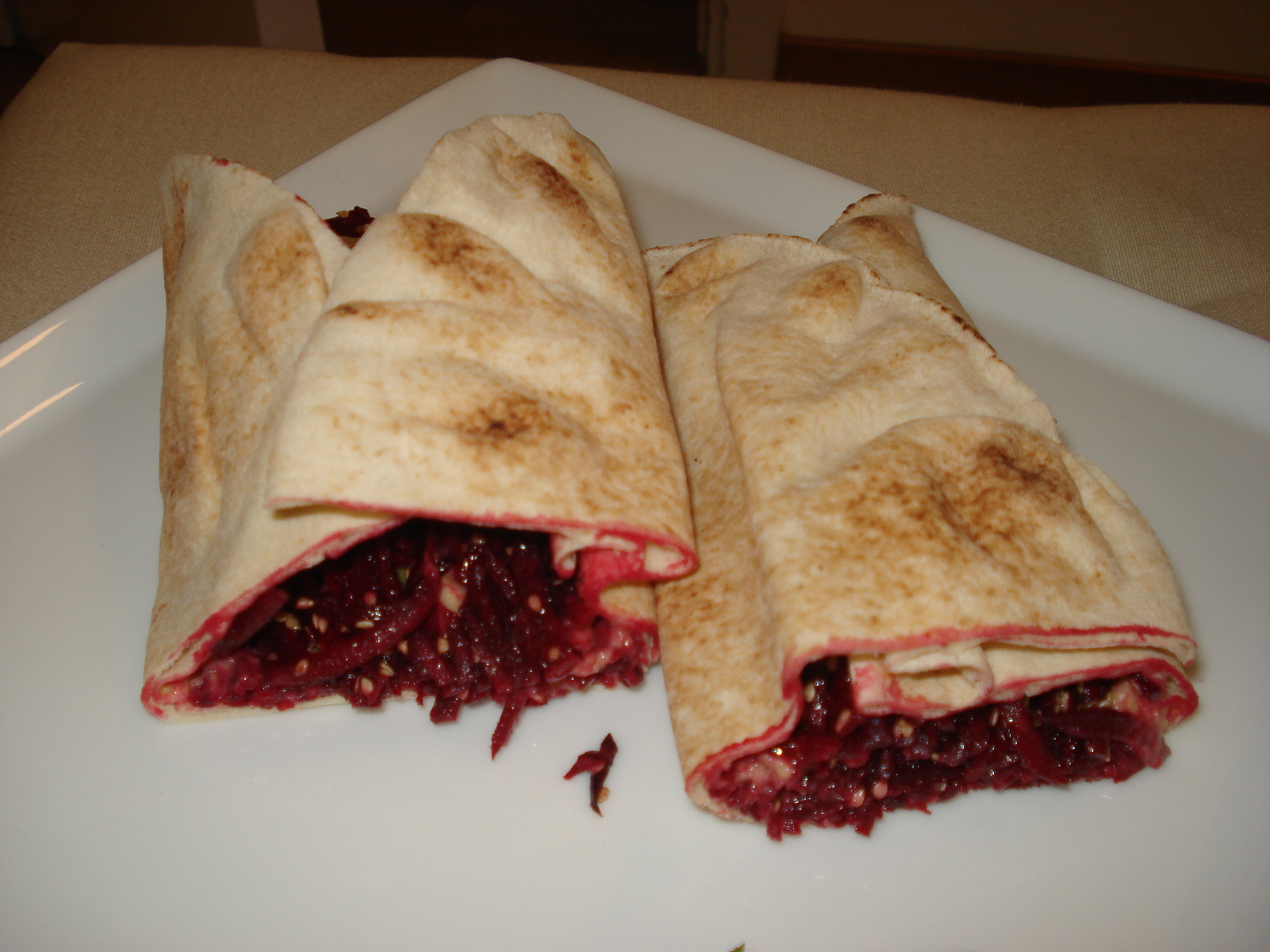 Tortilla rolls with beets and hummus