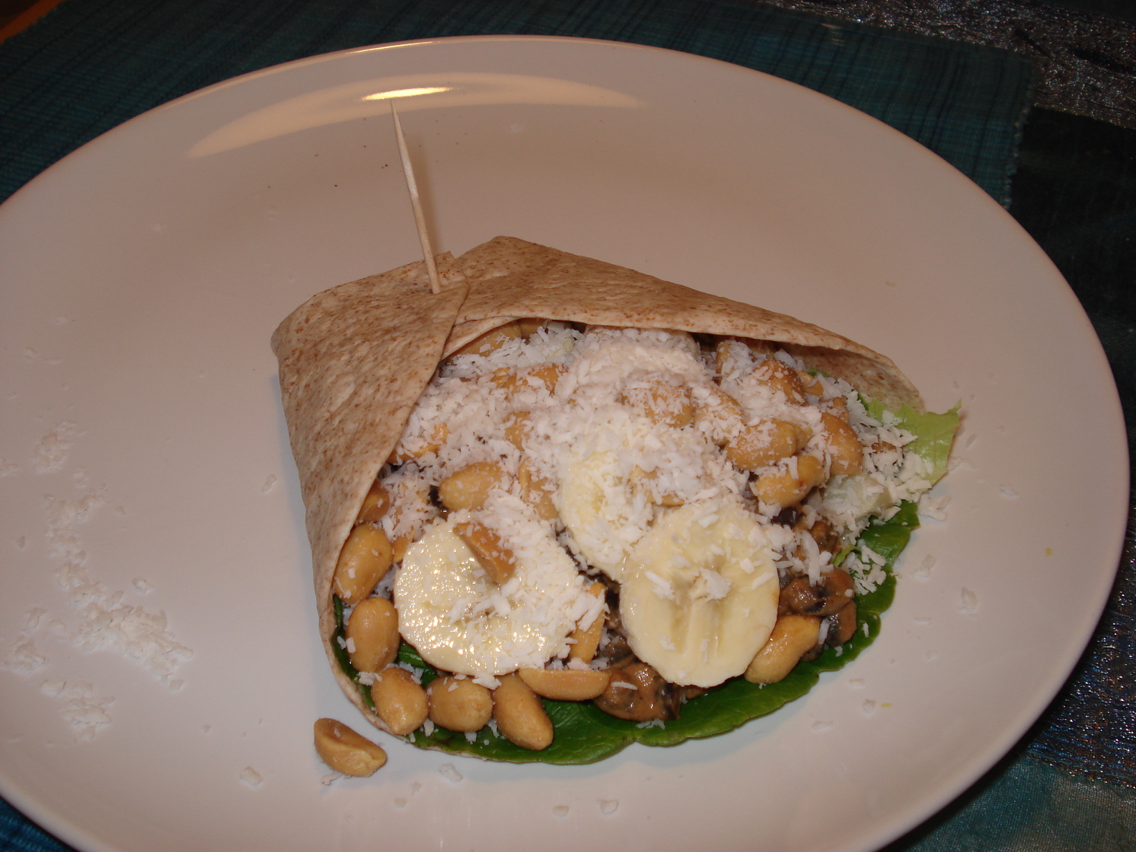 Wraps with curry beans, banana, peanuts and coconut