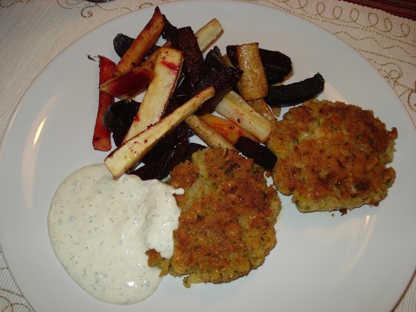 Yellow pea patties with roasted root vegetables and mustard-flavored sour cream