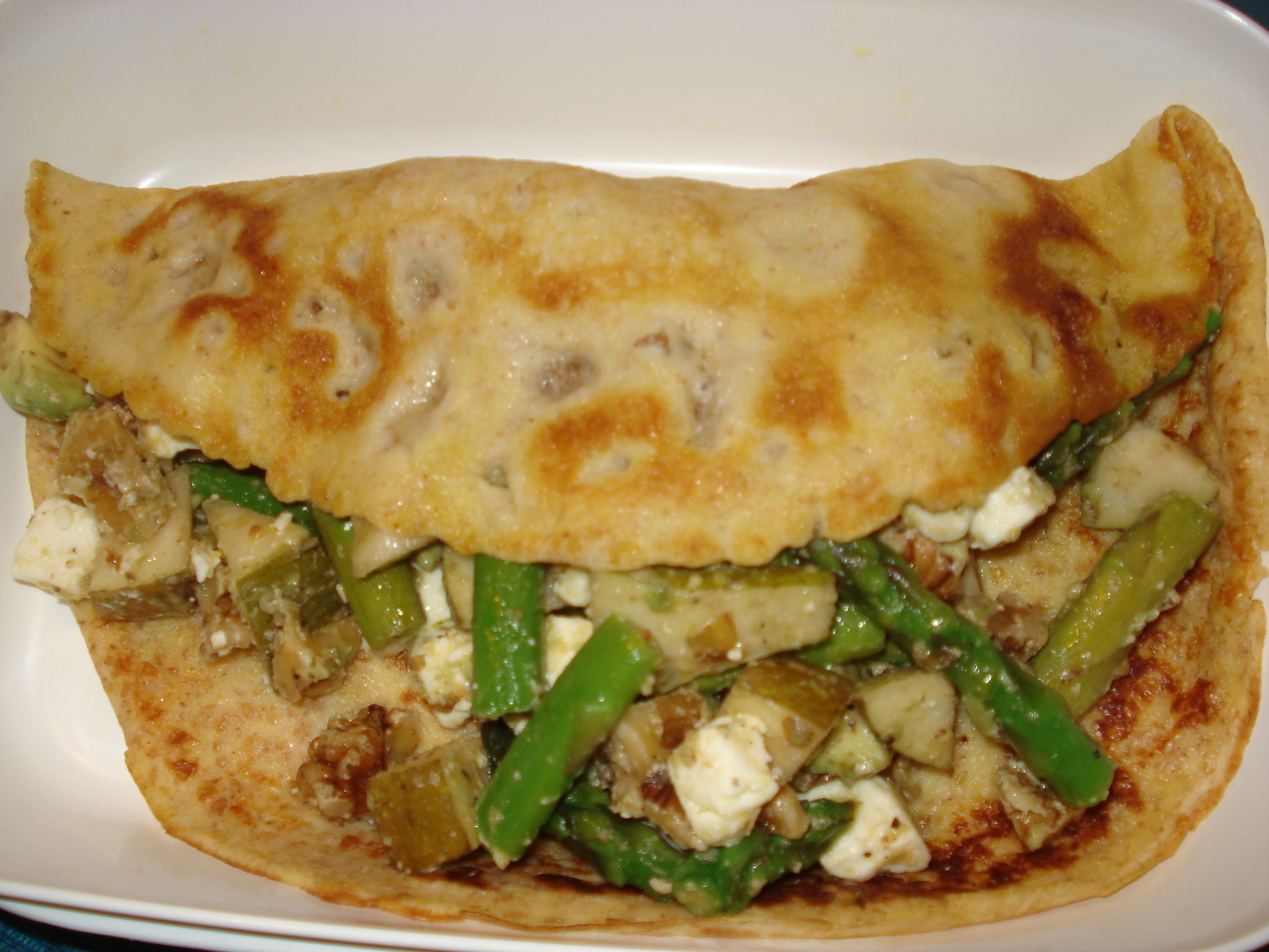 Crepes with feta cheese, walnuts, pears, asparagus and avocado